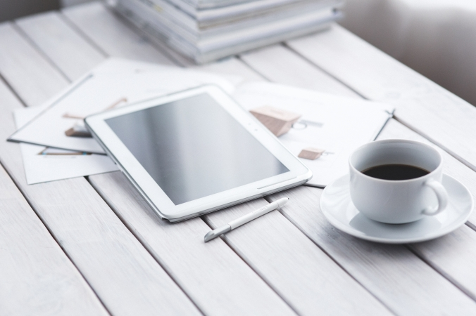 Canva - White tablet and cup of coffee (1)